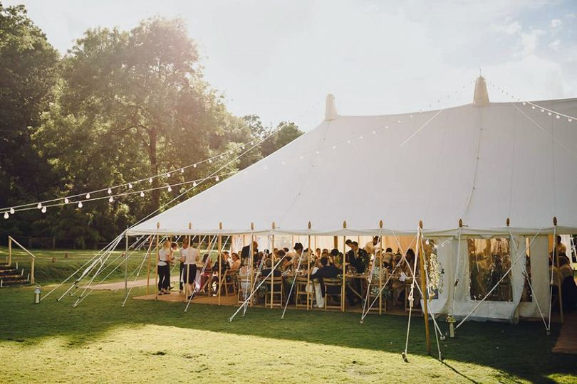 Canal Lake venue - Traditional pole marquee on the main lawn - courtesy of Modern Vintage Weddings