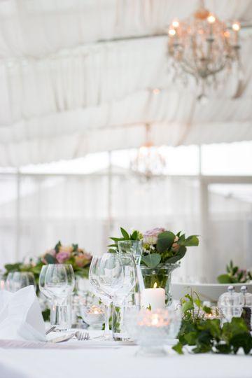 Glasses, candles, and floral arrangements