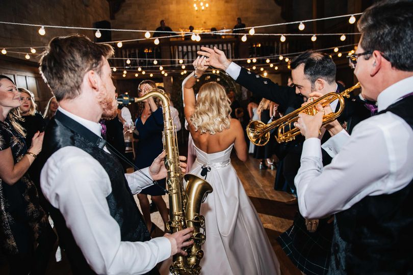 bride twirl with wedding band on the dance floor 4 258625 162068893581839