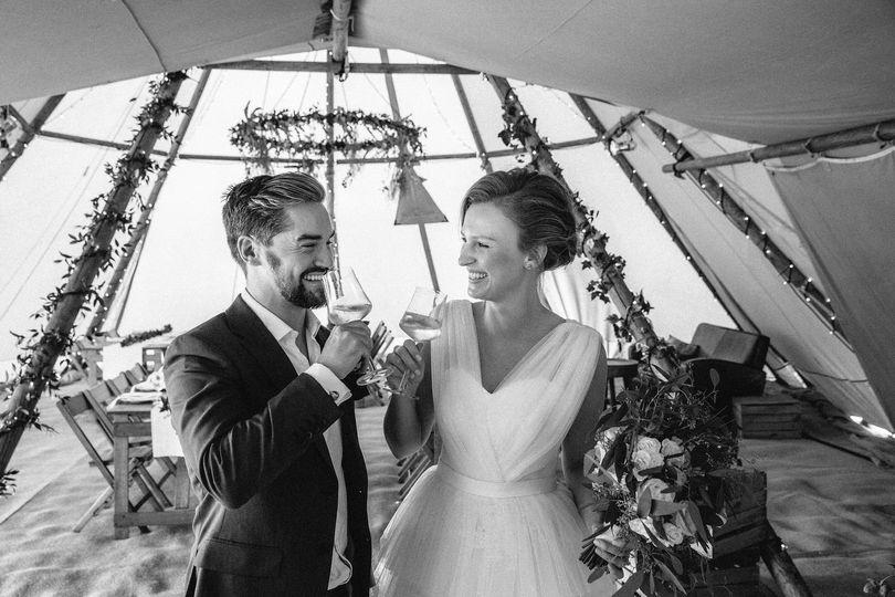 Upscale tipi tent wedding