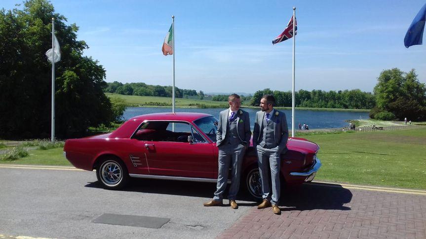 Men arrive in Red Mustang