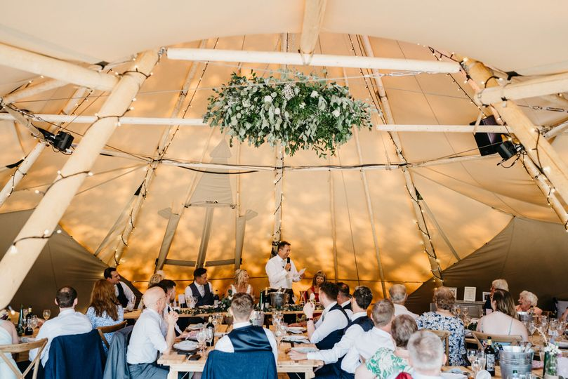Inside one of the four tipis