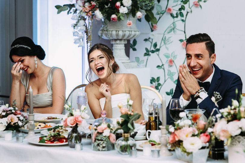Happy couple during speeches