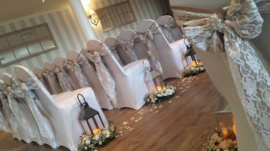 Chairs, lanterns, and floral decor