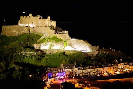 Mont Orgueil Castle lit up at night