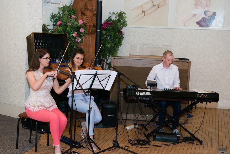 Two fiddles & piano accompanim