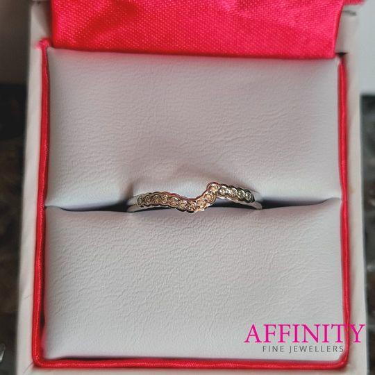 Demi-bezel shaped ring