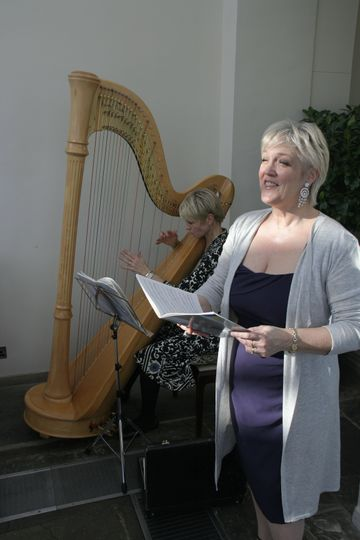 Singing with harpist