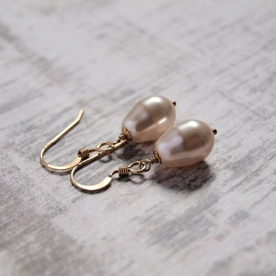 Gold pearl drop earrings.