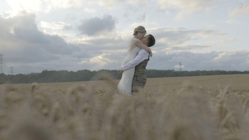 Newlyweds in a field
