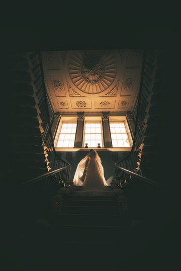 Bride on the stairs - Paul McGlade Photography