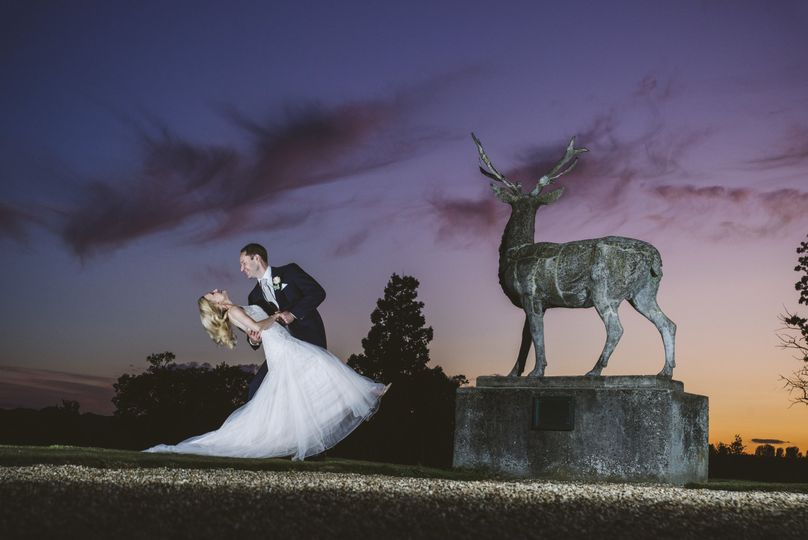 Newlyweds under a purple sky