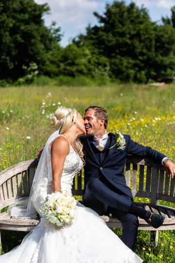 Couple seated on a bench - Rapid Image UK