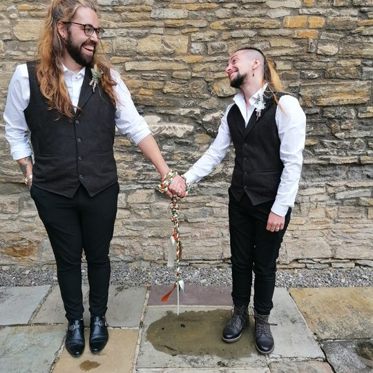 Wearing their handfasting cord