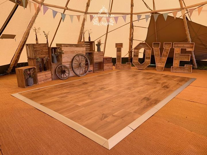 Booth, letters and a wooden dance floor