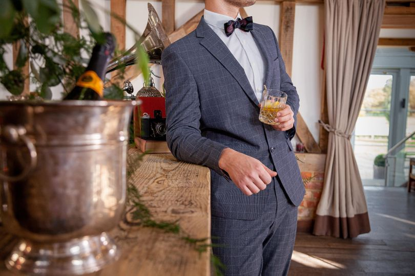 Groom at bar