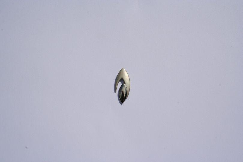 Silver Flame pin badge