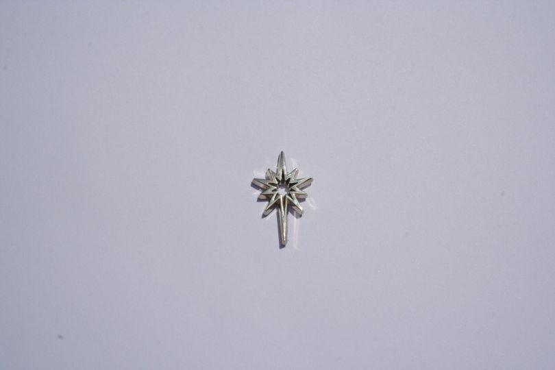Silver star pin badge