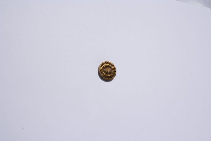 Bronze sunflower pin badge