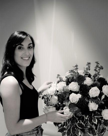 Rebecca arranging venue florals