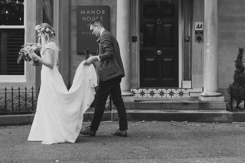 Bride and groom enjoy a casual moment after photographs