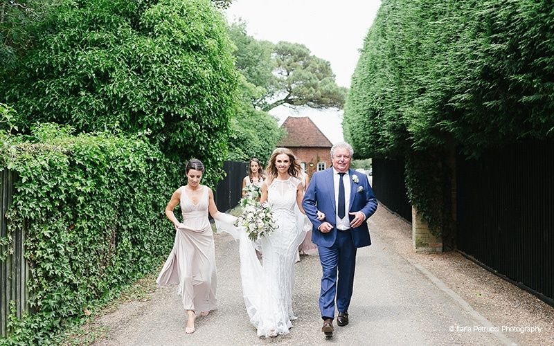 Bride with her father and bridesmaids