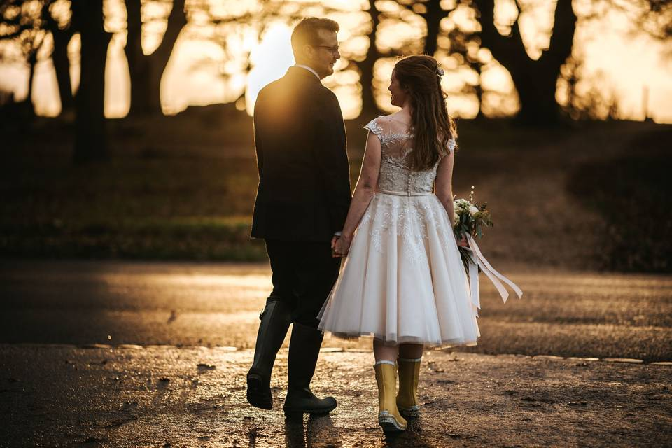 Couple holding hands - Blue Lily Weddings