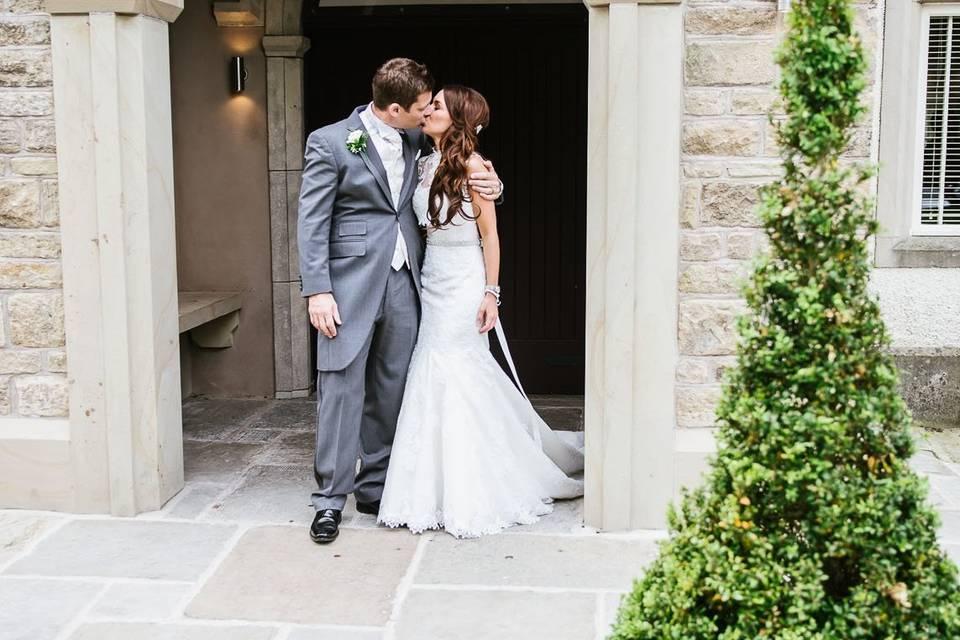Newlyweds outside Mitton Hall