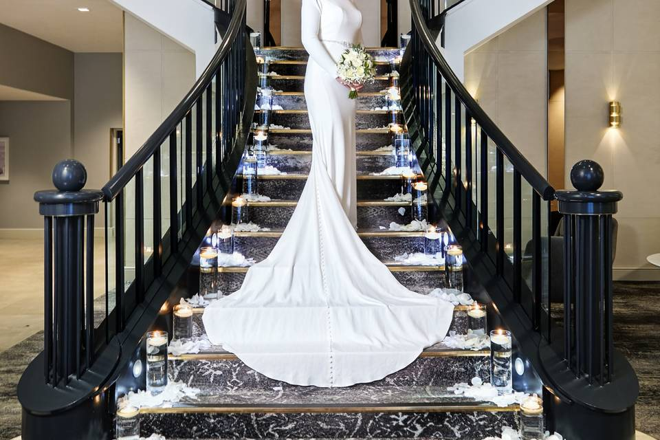 Bride on the hotel staircase