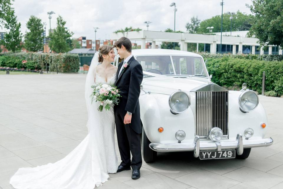 Bride and groom beside a classic car - Erika Rimkute Photography