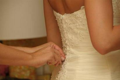 buttoning the dress