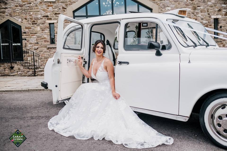 Classic white wedding taxi
