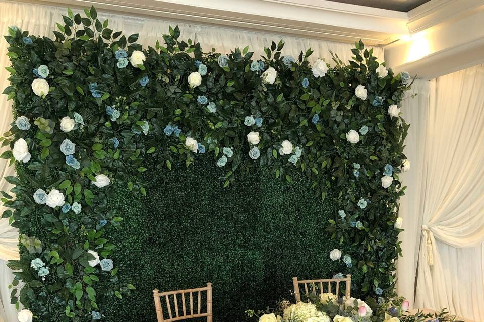 Green flower wall with garland