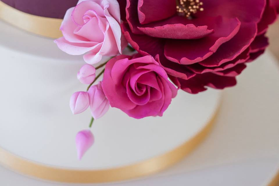 Two-tier fondant iced cake
