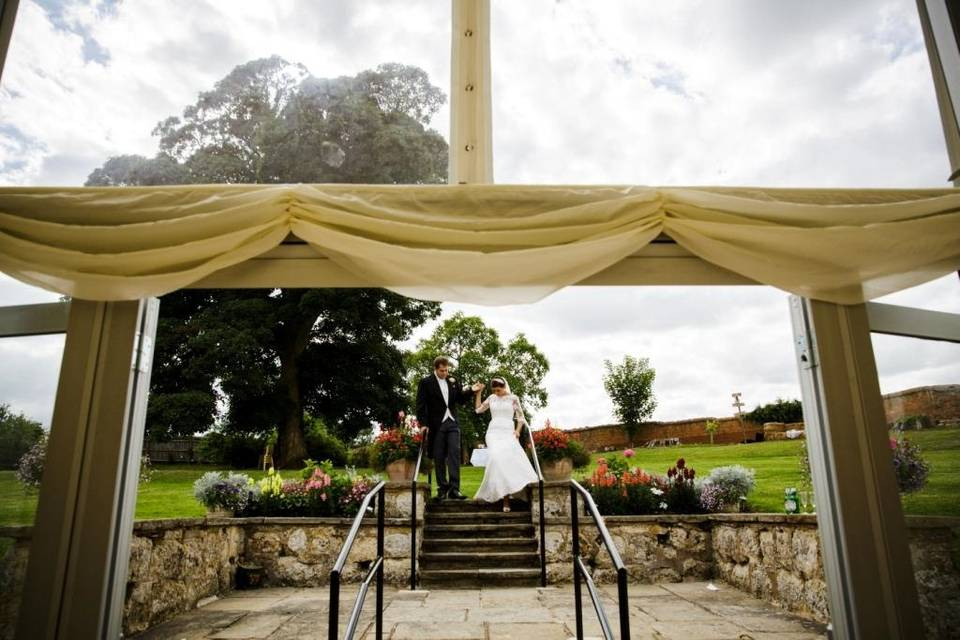 A bride and Groom making their entrance into the marquee.