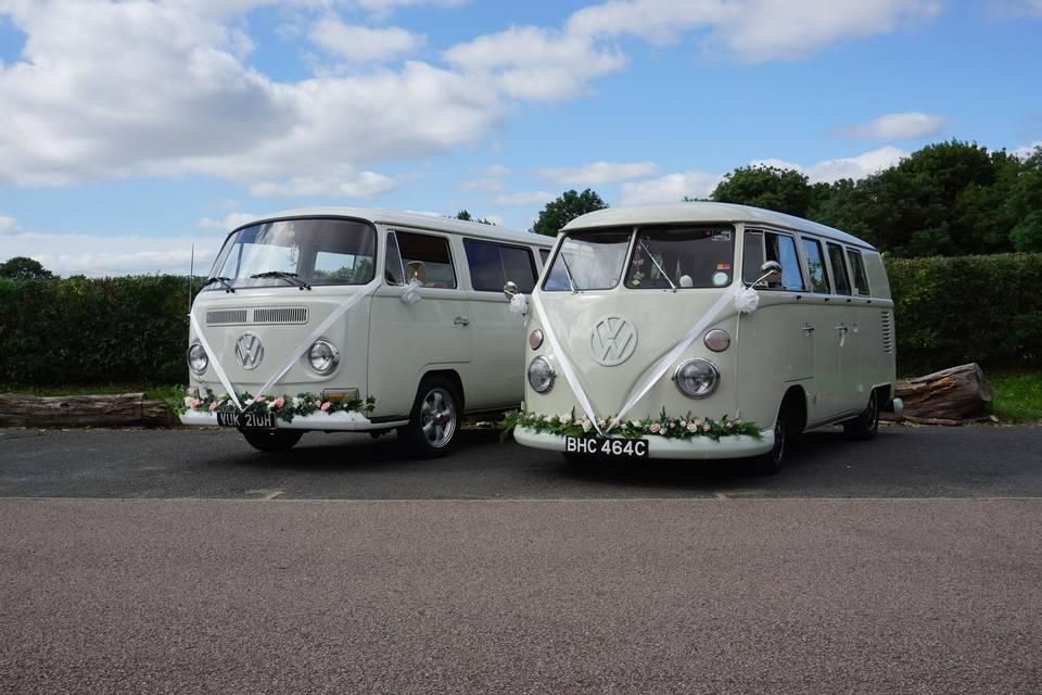 Two pearl white VW camper vans