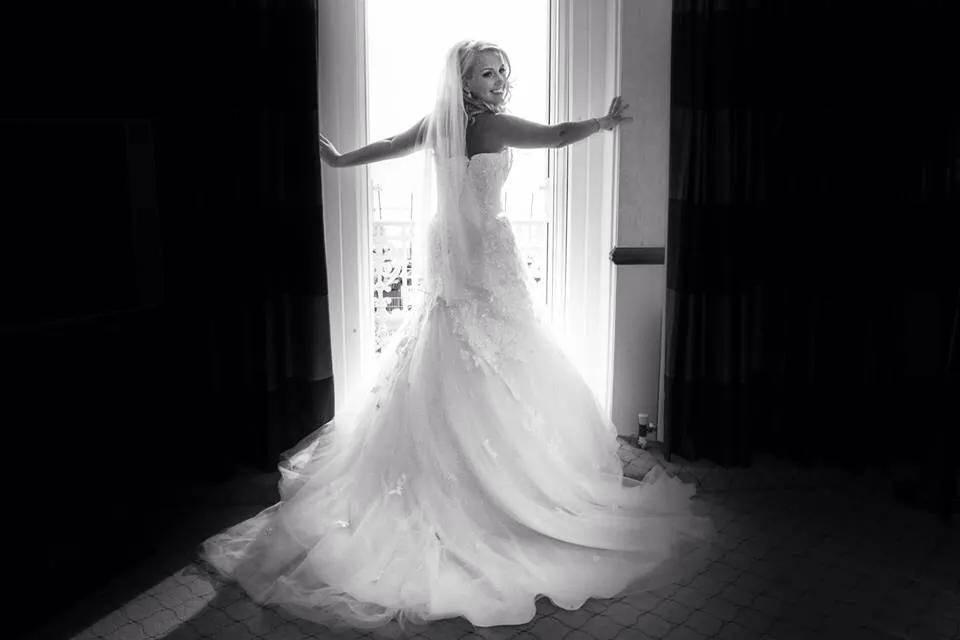 Bride looking out of the bridal suite.