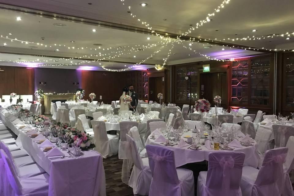 Purple and white reception decor