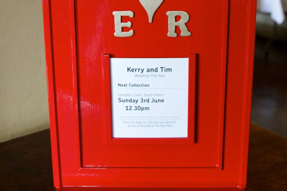 Red postbox at a wedding