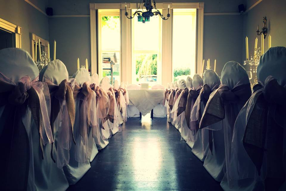 White chair covers with hessia