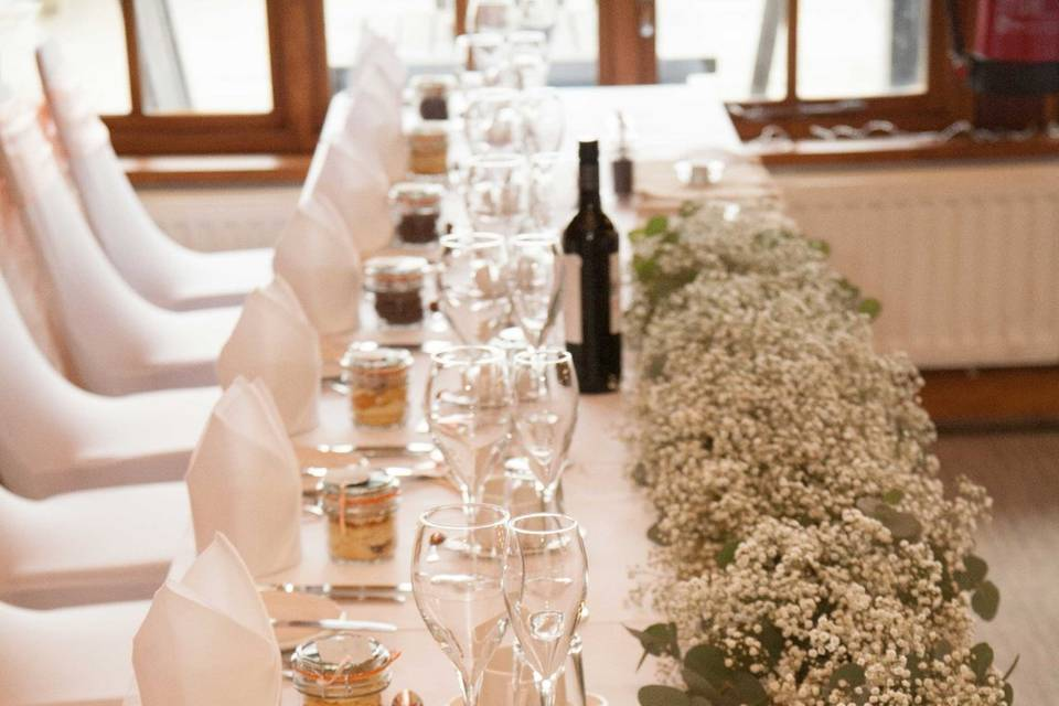 The head table set up lengthways for this wedding