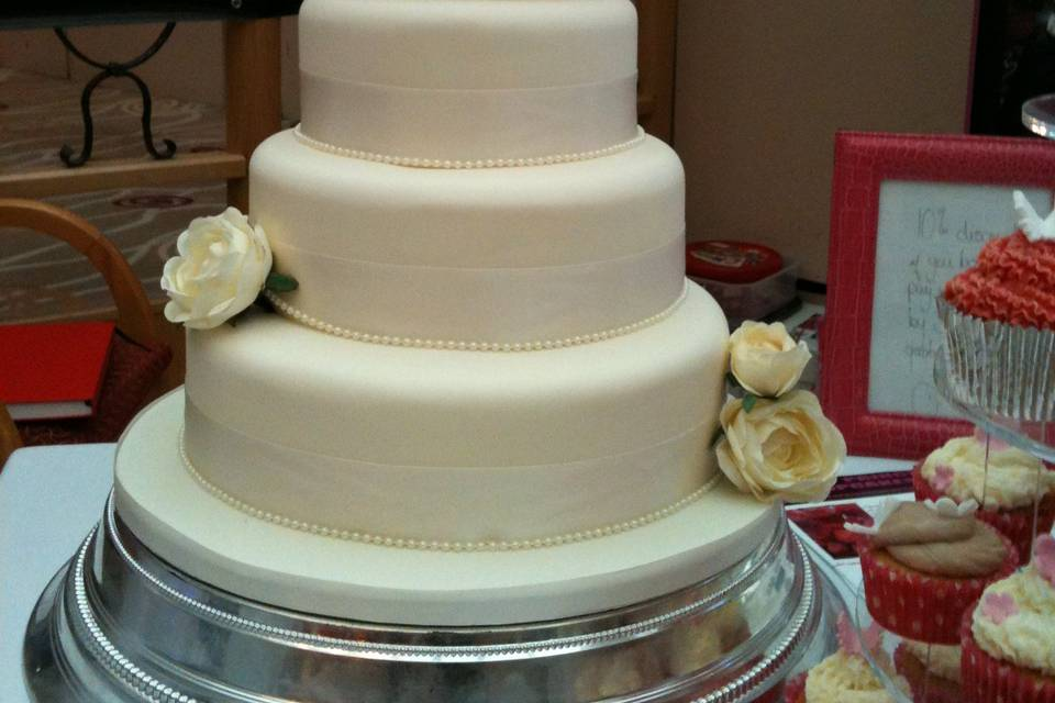 3 tier wedding cake with rose ball detail