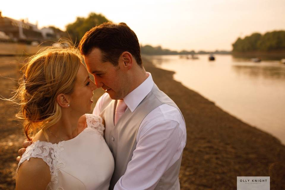 Couple pictured by the water - Olly Knight Photography