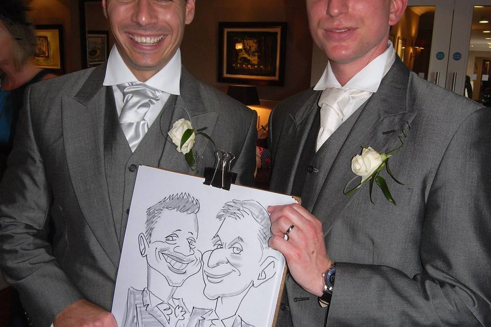 The Groom and Best man strike a pose for their caricature!