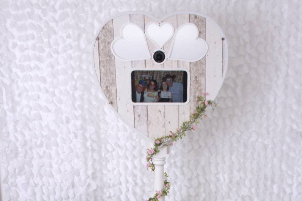 Heart-shaped booth with rustic decor