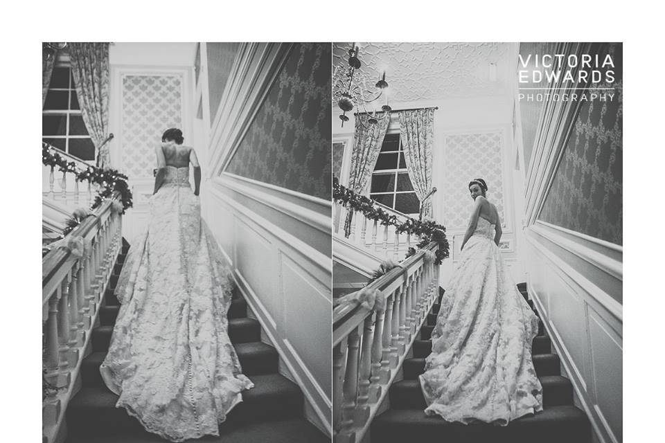 A gorgeous bride and dress on the staircase
