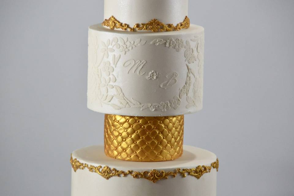 4 tier gold and white cake