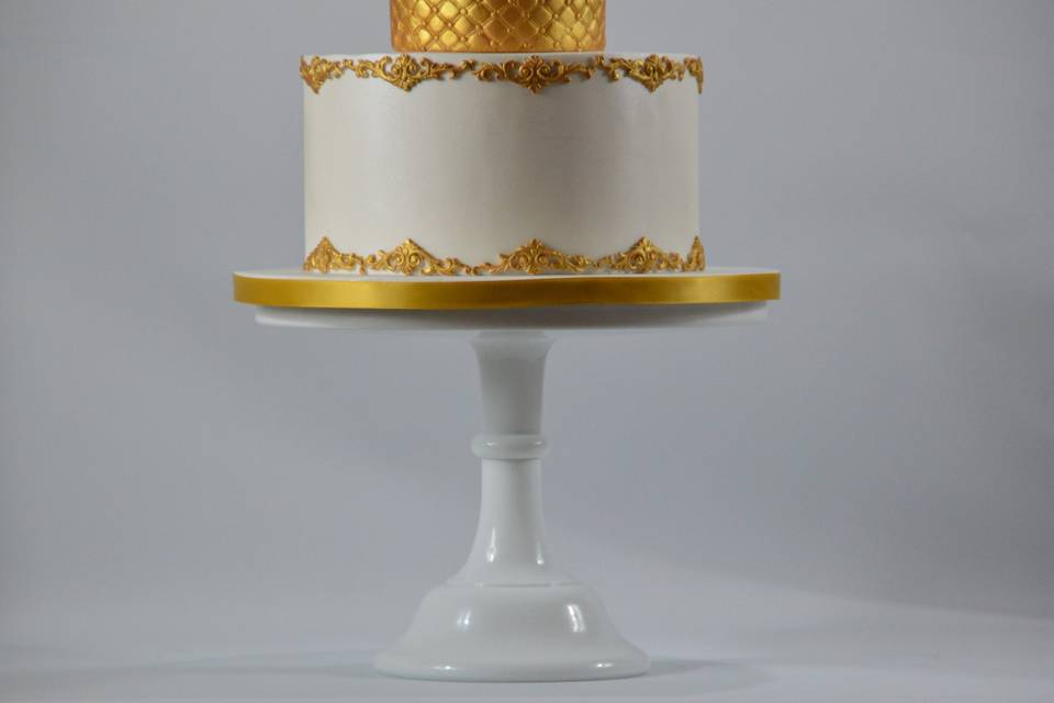 Gold and white decorated cake