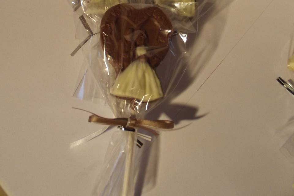 Bunch of bride and groom lolly