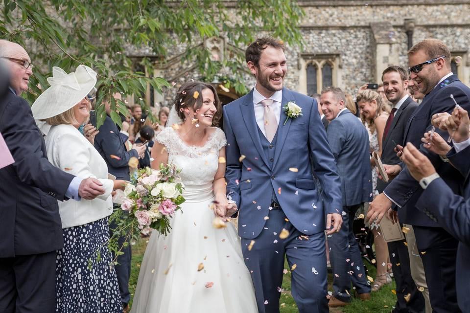 Newlyweds exiting ceremony